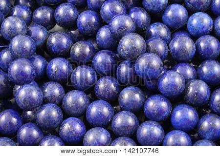 A close up image of lapis lazuli beads
