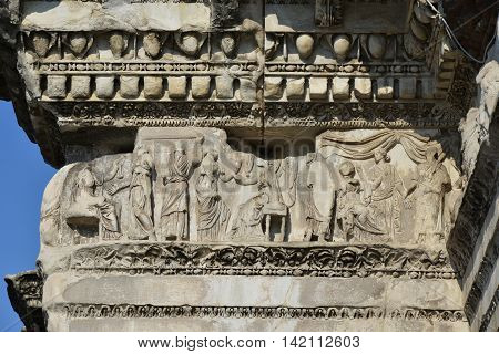 Scenes of weaving in ancient times on the Forum of Nerva ancient frieze, in Rome