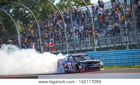Watkins Glen, NY - Aug 07, 2016: Denny Hamlin celebrates his victory in the #11 FedEx Freight Toyota  during the CHEEZ-IT 355 at the Glen at Watkins Glen International in Watkins Glen, NY.