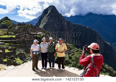 Tourists In Machu Pichu