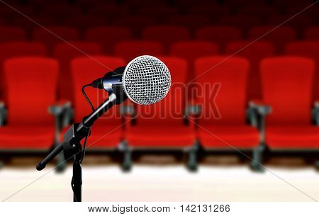 Microphone during seminar presentation with red seats