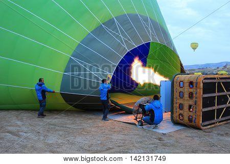 Cappadoccia Turkey: Men fill up hot air balloon in the early morning at Cappadoccia Turkey on February 17th 2016