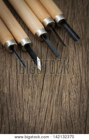 5 Pcs Wood Carving Carvers Working Chisel Hand Tool Set WoodWorking on the wooden table, selective focus carpentry chisel on wood background.