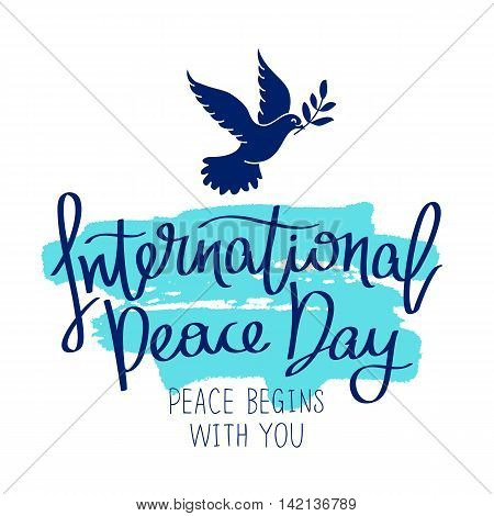 International Day of Peace. Peace begins with you. Trend calligraphy. Vector illustration on white background with a smear of ink blue. Dove with a palm branch. Excellent gift holiday card.