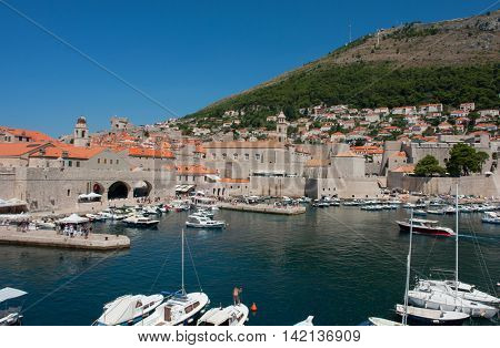DUBROVNIK, CROATIA - AUG 3, 2016: Harbour of the Old town of Dubrovnik, Croatia. Dubrovnik is a UNESCO World Heritage site