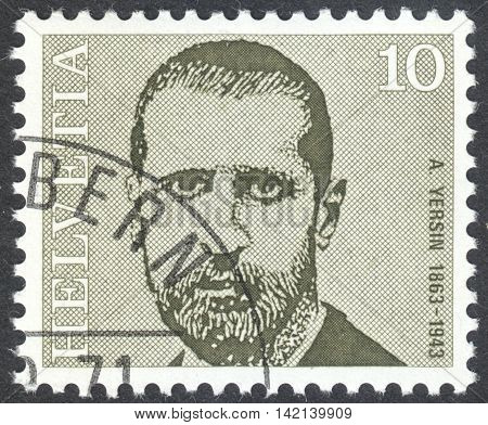 MOSCOW RUSSIA - CIRCA APRIL 2016: a post stamp printed in SWITZERLAND shows a portrait of Alexandre Yersin the series