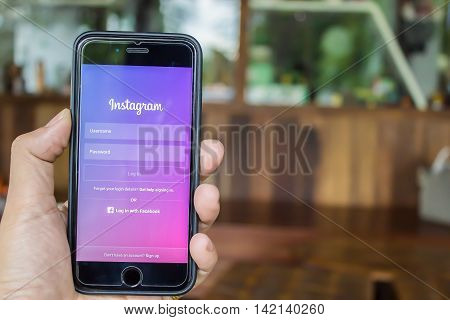 CHIANG MAI THAILAND - JUN 42016: A man holds Apple iPhone 6S with Instagram application on the screen. Instagram is a photo-sharing app for smartphones.