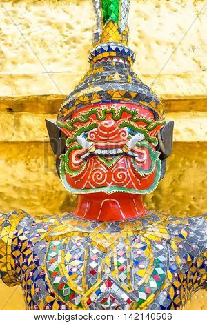 close up giant at thai template on gold pagoda