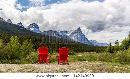 Canada Banff National Park With Chairs Andfoggy Mountains And Forest.