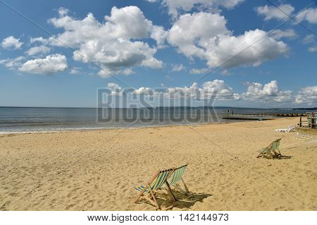 Deckchairs on beach on seafront at Bournemouth, Dorset