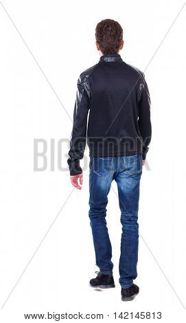 Back view of going  handsome man. walking young guy . Rear view people collection.  backside view of person.  Isolated over white background. Curly guy in a black leather jacket goes away.