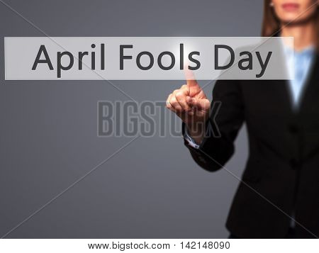 April Fools Day - Isolated Female Hand Touching Or Pointing To Button