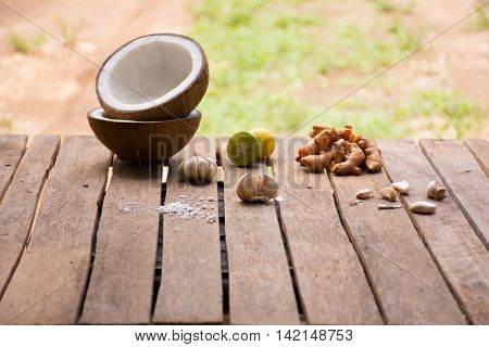 Raw material for food and dessert.Lemon and coconut   and turmeric on old wooden background outdoor.Raw material Asia food.Raw material Indian food