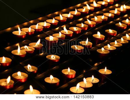 Candles Lit Inside The Place Of Worship