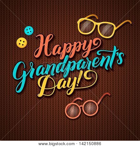 Happy Grandparents Day Calligraphy Greeting Card in Brown Knitted Background with Glasses and Buttons.