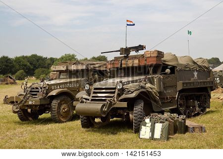 WESTERNHANGER, UK - JULY 20: Two vintage US army WW2 armoured halftracks stand on public display in the living history section at the War & Peace Revival show on July 20, 2016 in Westernhanger