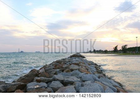 The rock wall on the PMY beach in evening time between sunset