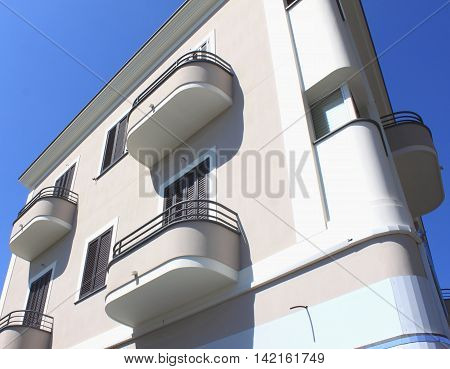 fragment of modern architecture with balconies against the blue sky