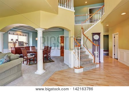 House, Interior With Staircase In Large Hall With Hardwood Floor