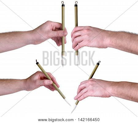 Hands with Japanese calligraphic brush - art supplies
