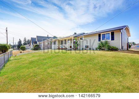 American Rambler Exterior With Grass Filled Garden.