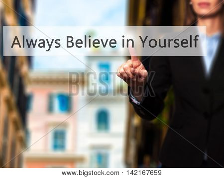 Always Believe In Yourself - Isolated Female Hand Touching Or Pointing To Button