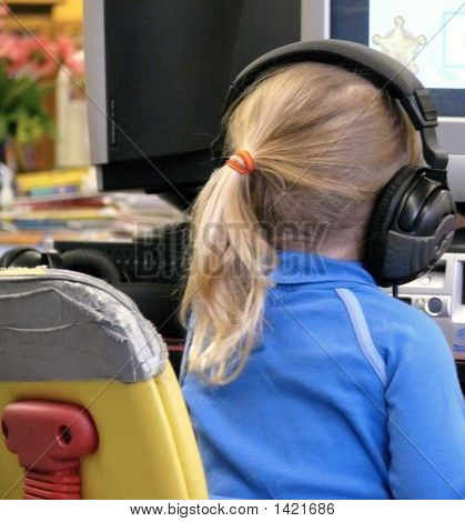 Child With Big Headphones