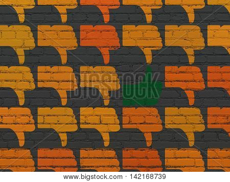 Social network concept: rows of Painted orange thumb down icons around green thumb up icon on Black Brick wall background