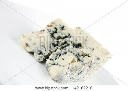 soft moldy stilton cheese on white dish