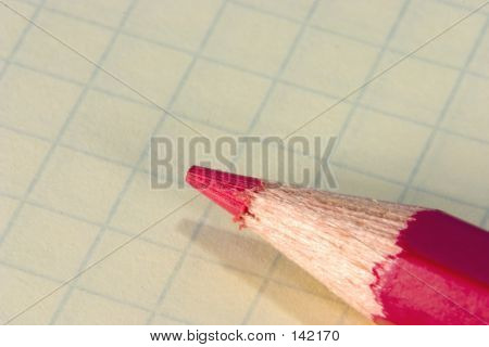 Red Pencil On Notepad