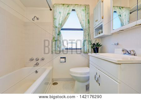 Old Style Bathroom Interior  With White Cabinets