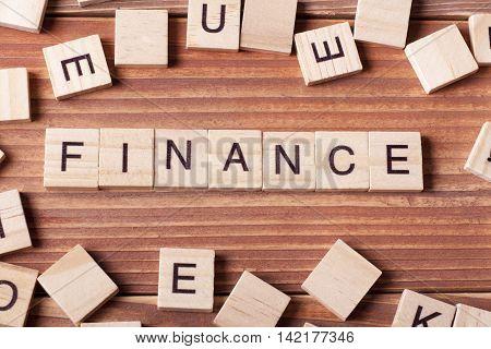 FINANCE word written on wood block. wooden abc.
