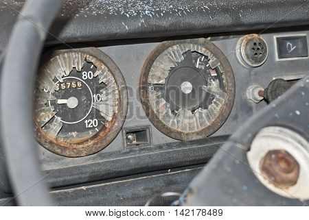 Car dashboard with speedometer and rev broken
