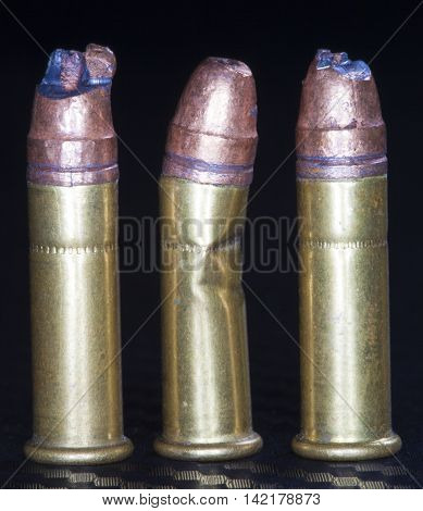 Three rimfire rounds that have been damaged and are unusable