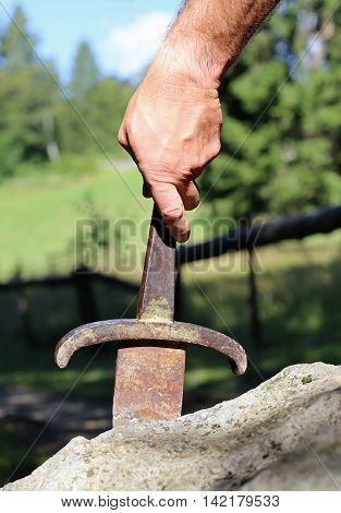 Excalibur Sword In The Stone And The Hand Of Man