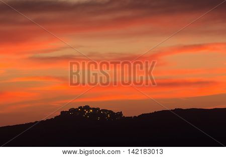Village Of Sant' Antonino In Corsica Silhoutted Against Pink Evening Sky