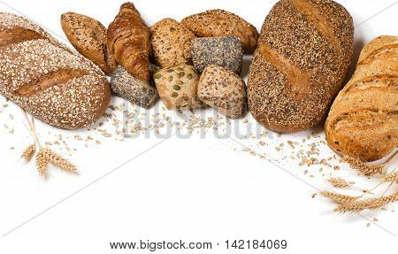 Frame of bakery product assortment with bread loaves buns rolls and croissants decorated with grains of sunflower oat flax wheat and poppy isolated on white background.