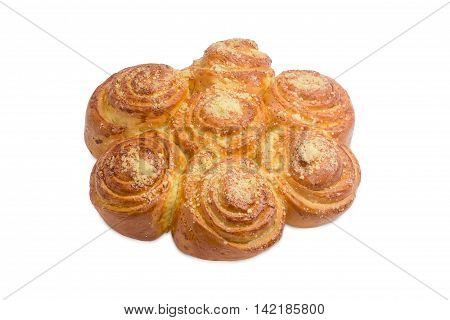 Several cinnamon roll conjunct together after baking and sprinkled with sugar on a light background