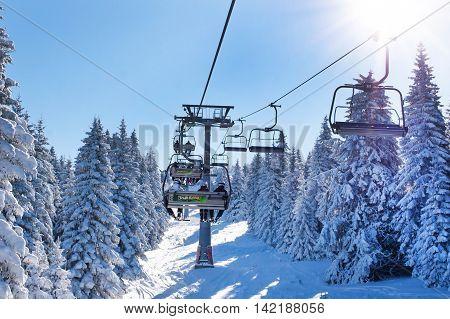 Kopaonik, Serbia - January 22, 2016: Ski resort Kopaonik, Serbia, people on the ski lift among the snowy white pine trees