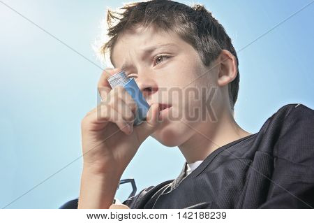 A teen having a asthma problem with sky on the background