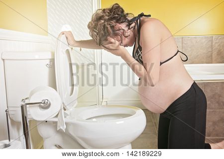 A Pregnant woman having morning sickness during Pregnancy. Concept photo of pregnancy, pregnant woman lifestyle and health care.copyspace