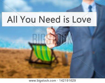 All You Need Is Love - Businessman Hand Holding Sign