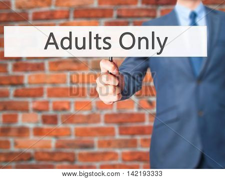 Adults Only - Businessman Hand Holding Sign