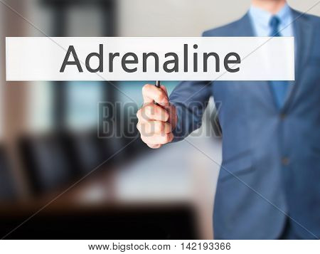 Adrenaline - Businessman Hand Holding Sign