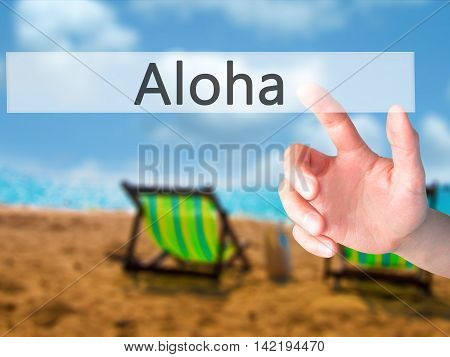 Aloha - Hand Pressing A Button On Blurred Background Concept On Visual Screen.