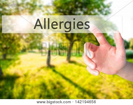 Allergies - Hand Pressing A Button On Blurred Background Concept On Visual Screen.