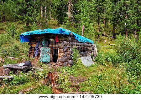 Small Buryat winter hut hunting in mountain taiga . Eastern Sayan . Russia