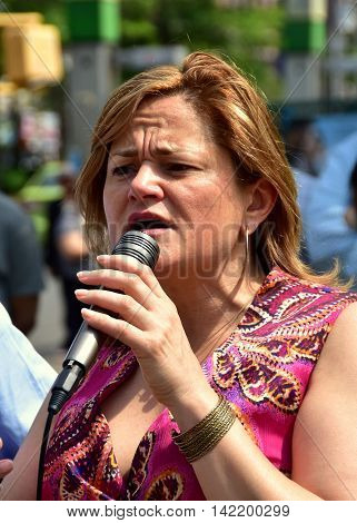New York City - May 27 2016: NYC Council Speaker Melissa Mark-Viverito speaking at an environmental free reuseable bag giveaway in Hamilton Heights