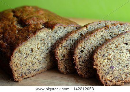 Banana Bread Loaf. Sliced on a wooden board