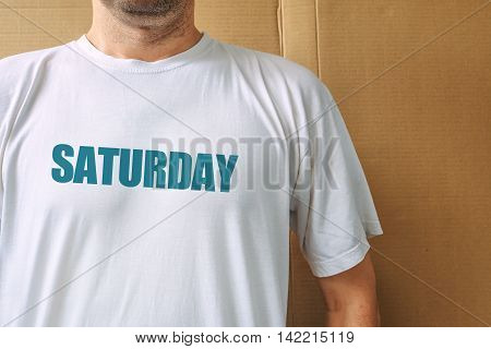 Days of the week - saturday man wearing white t-shirt with name of the sixth weekday printed